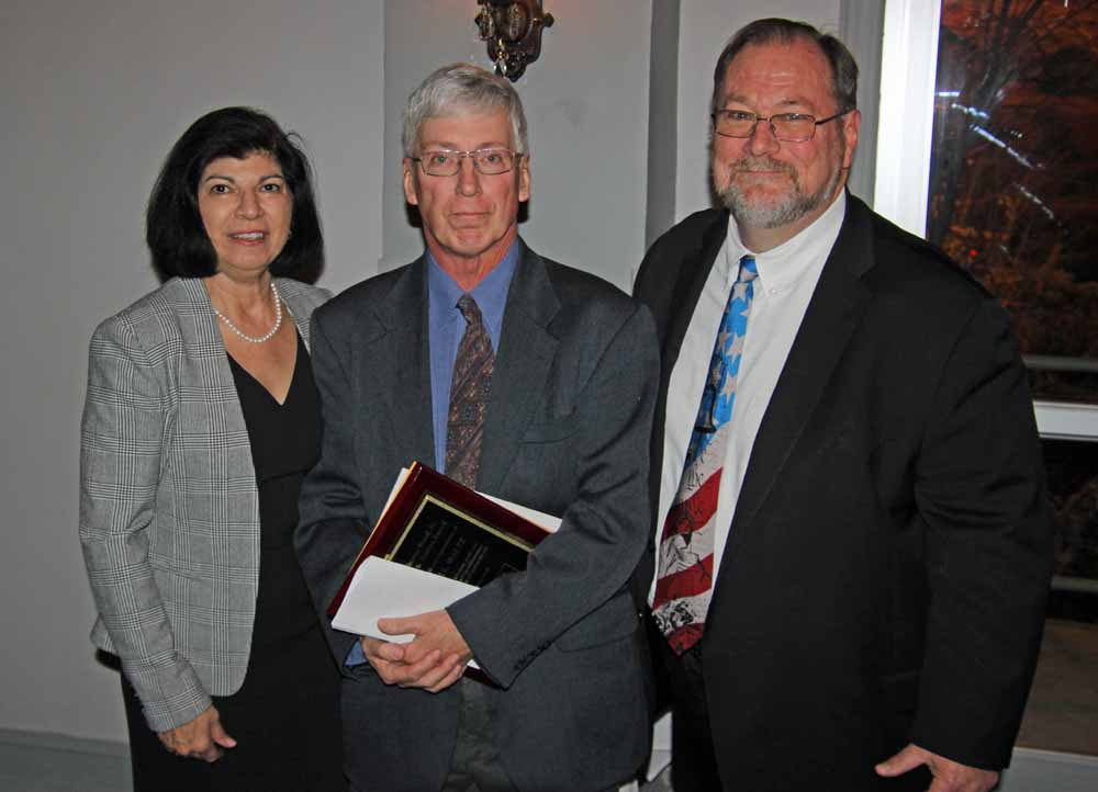Anne N. John, PBA President and David Keller Trevaskis presenting the PBA pro bono award to Kristine's husband Steve Sorage